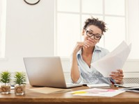 Smiling business woman reading document