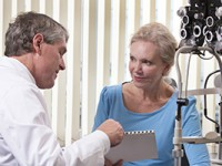 Ophthalmologist counseling female patient regarding her eye condition.