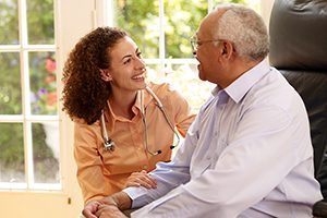 A doctor giving dental, vision and hearing tips to a caregiver.