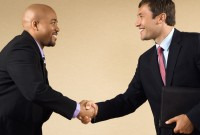 Handshake between business men on a mergers and acquisitions deal