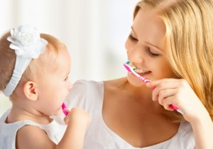 ChildMotherBrushingTeeth