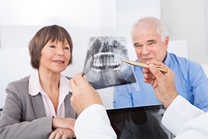 Elder Couple Reviewing dental X-ray with dentist