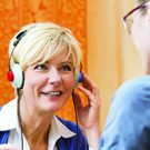 woman takes a hearing test