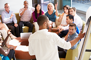 Engaged employees sitting in a meeting