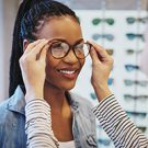 Young woman selecting glasses
