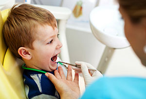 Young child getting teeth inspected at dentist