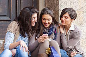 Beautiful Young Women Chatting using Mobile Phone