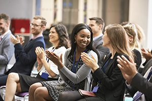Audience Applauding Speaker After Conference Presentation. Keep the Best Employees.