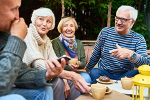 Senior friends with good hearing health enjoying time outdoors.