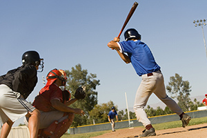 Player at bat, hoping he doesn't get hit by pitch which could cause retina damage from disease and injury.