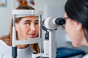 Eye doctor giving female patient an examination.