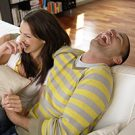 Couple enjoying financial health and having fun at home.
