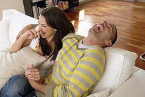 Couple enjoying financial health and having fun at home.