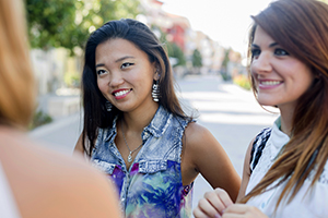 Young Asian woman talking with a friend.