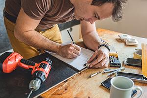 Man making draft plan using pencil.