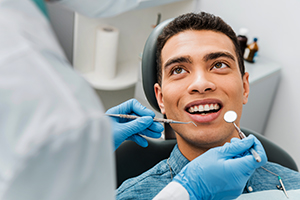 Male sitting in dental chair at his dental appointment.