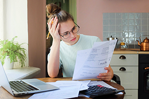Young woman looking at options for repaying student loans.