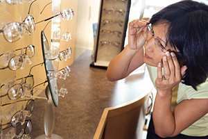 Woman trying on eyeglasses.