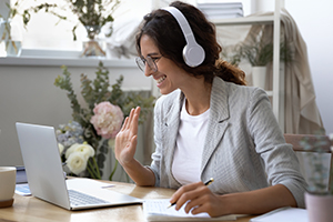 Smiling woman in headset have inline educational course.