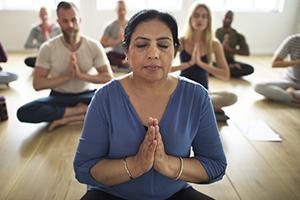 Folks meditating during yoga class.
